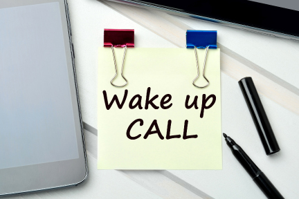 picture of a sticky note that says wake up call