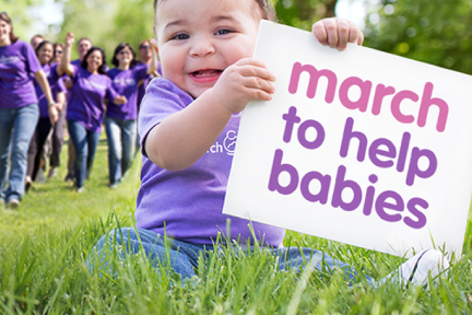 picture of a child holding a sign that says march to help babies