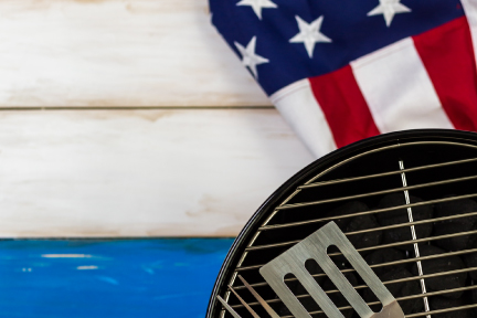Picture of a barbeque grill and an american flag
