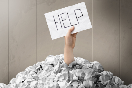 picture of a person holding up a sign that says help
