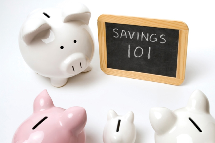picture of piggy banks around a chalkboard that says savings 101