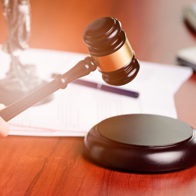 Picture of a gavel and legal documents.