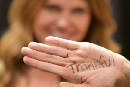 picture of a person with the word thankful written on their hand