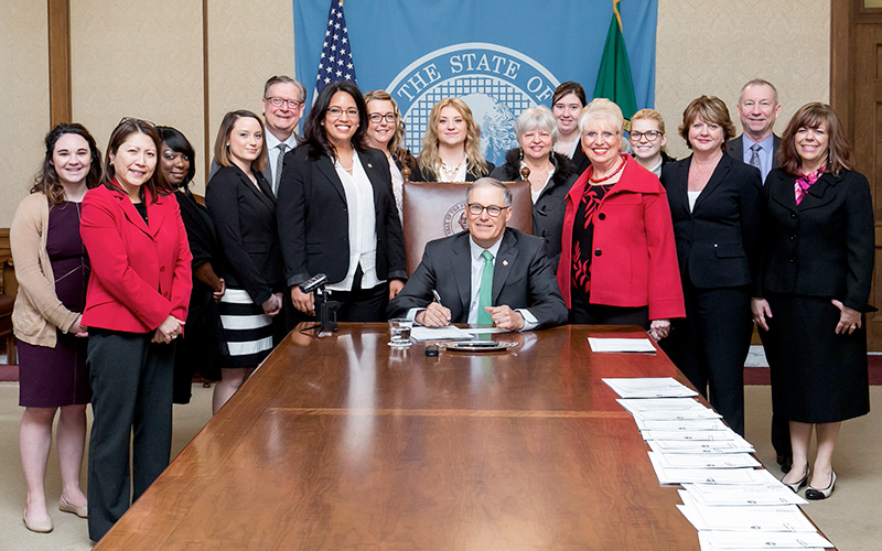 Picture of Gov. Inslee signing Senate Bill