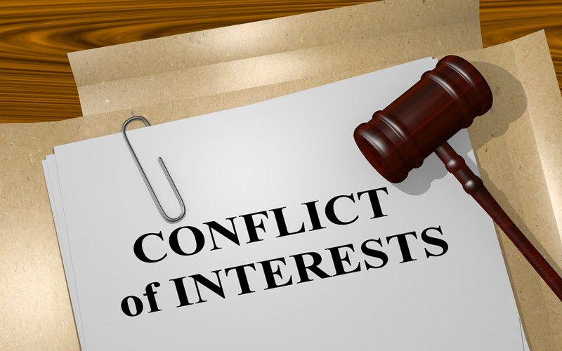 Picture of conflict of interests on legal document