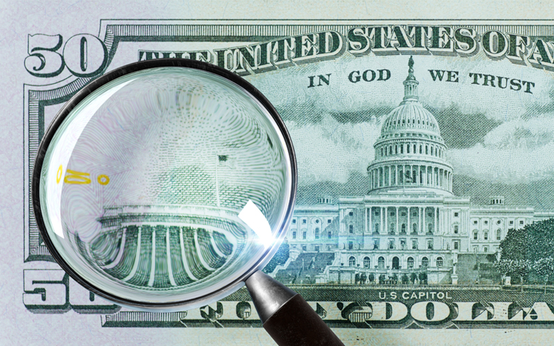 50 US dollars under a magnifying glass. close-up