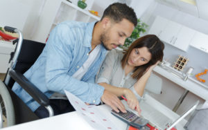 young attractive couple accounting at home