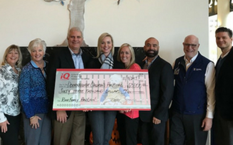IQ Credit Union members hold donation check to support Doernbecher Children's Hospital in Portland, OR.