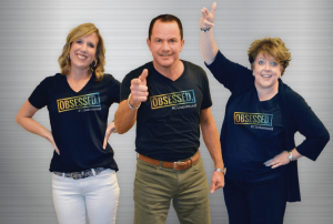 Jennifer Wagner, Troy Stang, and Denise Gabel wearing CUobsessed shirts