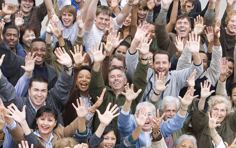 Picture of group of happy multiethnic people raising hands together
