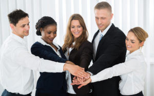 Picture of Group Of People Stacking Hands Over Each Other