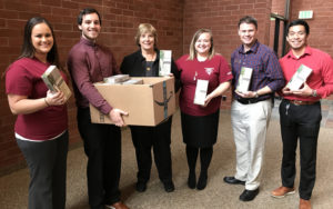 Picture of Clackamas CU staff with 60 boxes of chemical light sticks for Mt. Hood Search and Rescue.