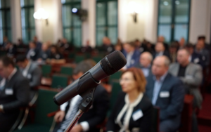 Picture of Microphone in focus against blurred audience