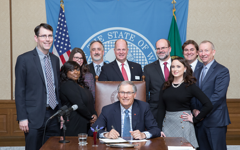 Picture of Washington Governor Jay Inselle signing bill 1209