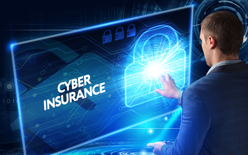 Picture of a man working on the tablet virtual display: CYBER INSURANCE