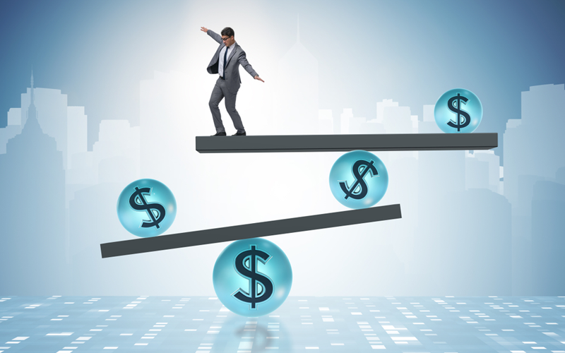Picture of Businessman balancing in financial dollar concept