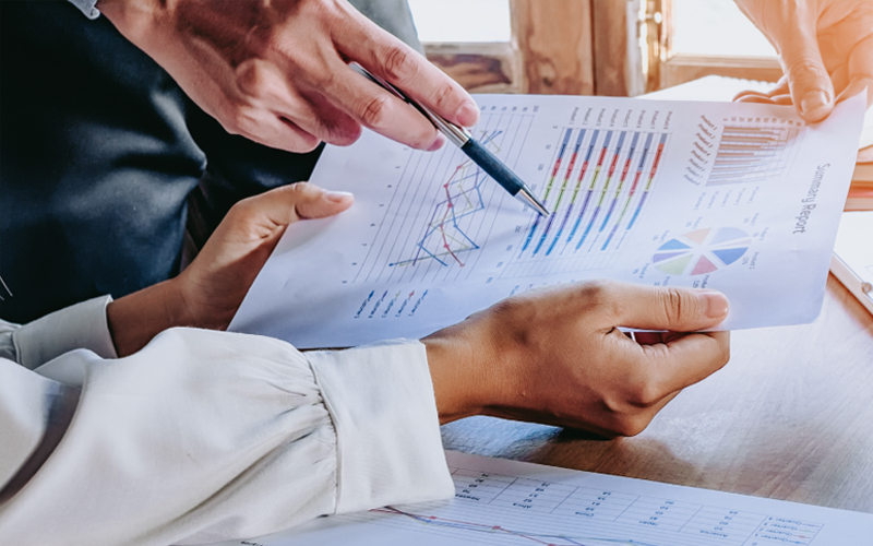 Picture of man holding a graph