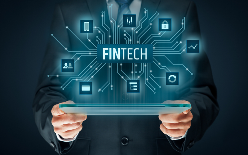 Picture of person with tablet and fintech illustration
