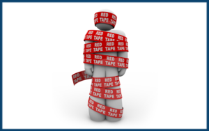 Picture of A person is wrapped up in red ribbon with the words Red Tape repeated