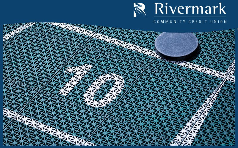 Picture of Rivermark CU logo and Shuffleboard court