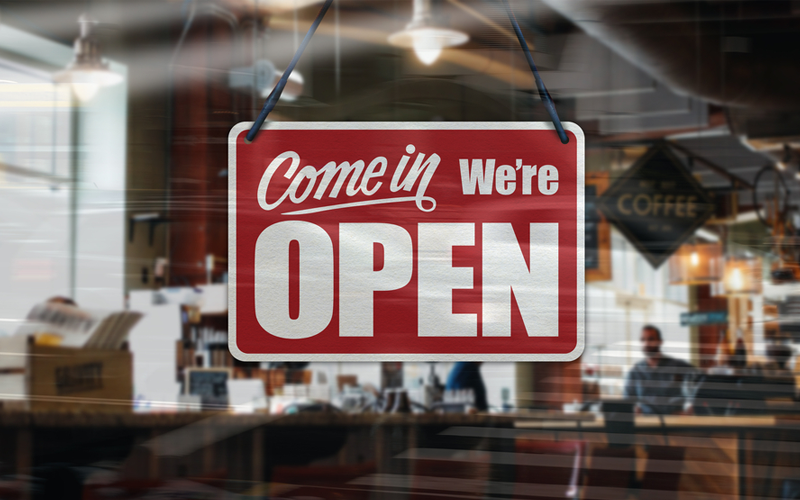 Picture of A business sign that says Come in We're Open