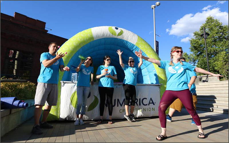 Numerica Credit Union Employees in front of branded bouncy castle