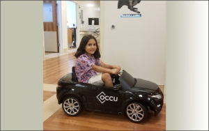 Child riding in an electric car.