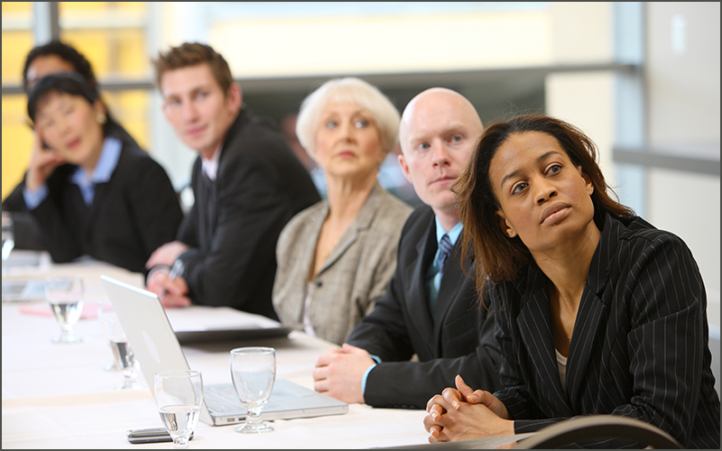 People sitting at board room table