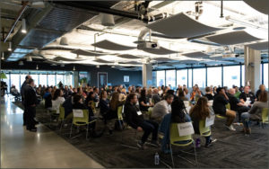 Meeting room filled with Seattle Credit Union staff for the Poverty Simulation
