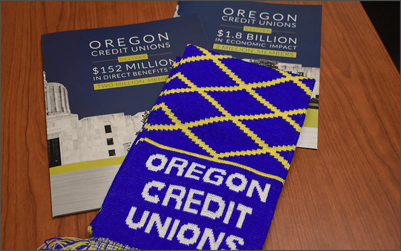 Brochure and Oregon Credit Union Day scarf